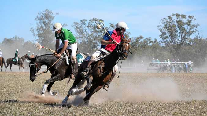 KICKING UP THE DUST: Competitors dash for the posts at the Wandoan Polocrosse Carnival.
