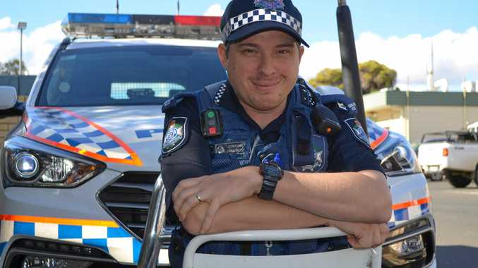 HERO COP: Constable Chris Metcalf has been hailed a hero by peers.