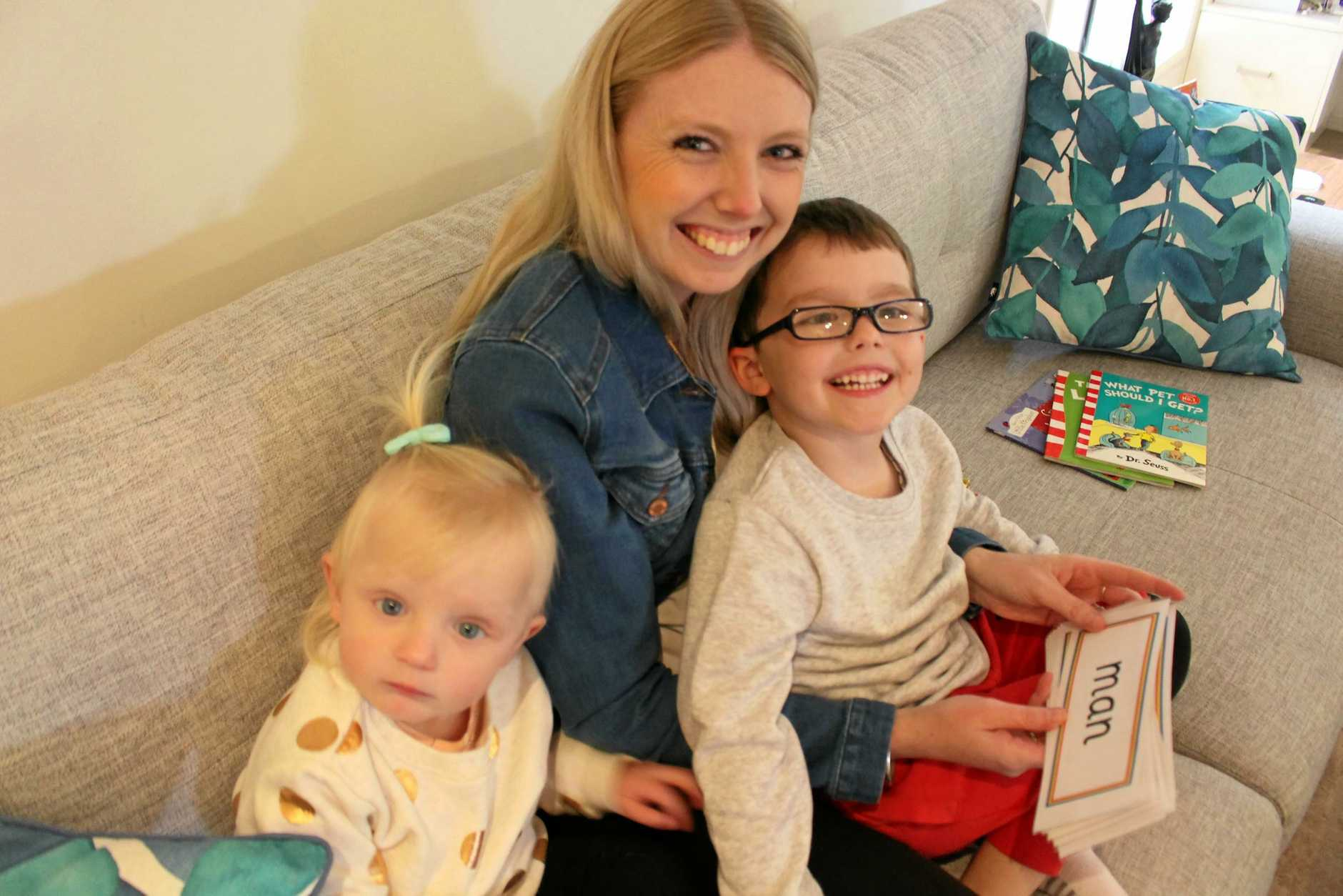 Felix (5) and Heidi (2) Lubben enjoy reading on the couch with their mother Holly Lubben. Books, kids, reading, literacy, Warwick, family, parenting, mother, literacy, early childhood, kindergarten