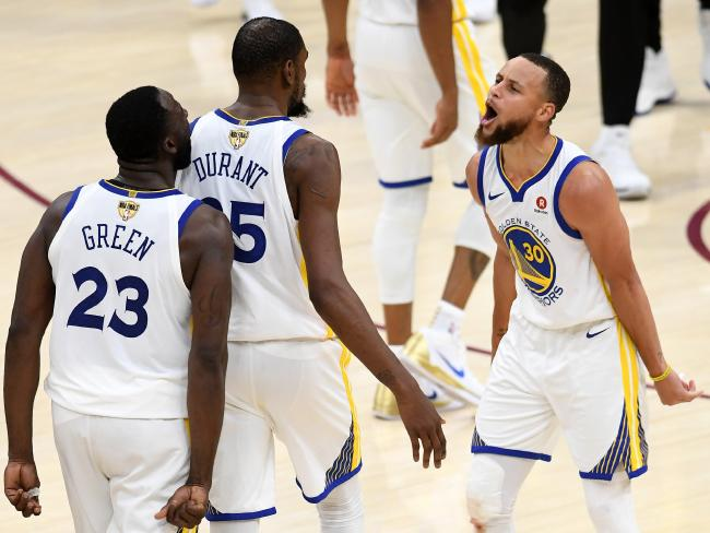 Stephen Curry (R) and Draymond Green (L) celebrate Kevin Durant's game-clinching three. Pic: Getty
