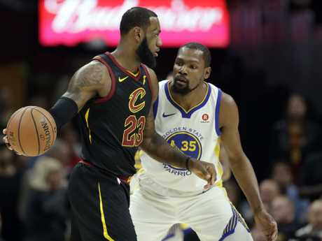 LeBron and KD go head to head. (AP Photo/Tony Dejak)