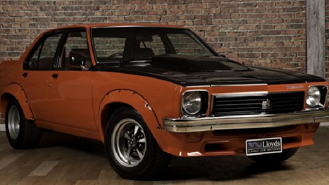 An A9X Torana in Mandarin Red is also going under the hammer. Picture: Supplied.