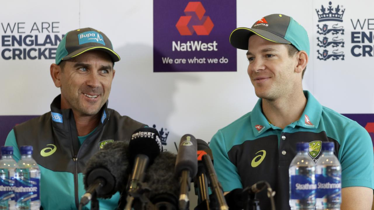 Australia cricket team Head Coach Justin Langer, left, and captain Tim Paine smile during a press conference at Lord's Cricket Ground in London, Wednesday, June 6, 2018. The media conference was Cricket Australia's arrival conference ahead of the Royal London ODI series against England. (AP Photo/Kirsty Wigglesworth)