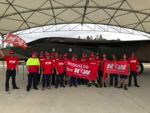 Workers protest 'paltry' pay offer at RAAF base