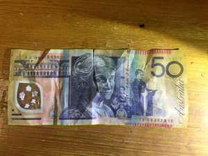 Customer used fake cash at Mackay business