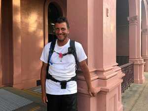 Man walking 2500km for charity drops into Bundy