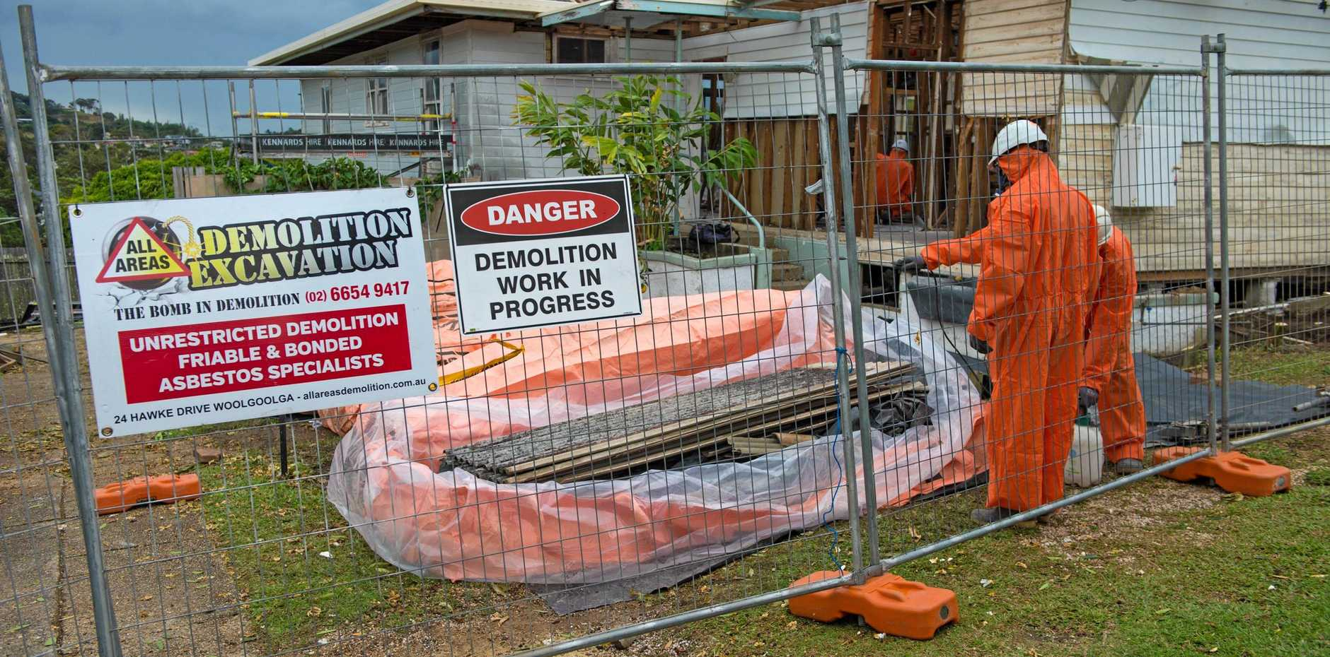 NO HALF MEASURES: Asbestos removal and disposal is serious business. This is not a DIY project.
