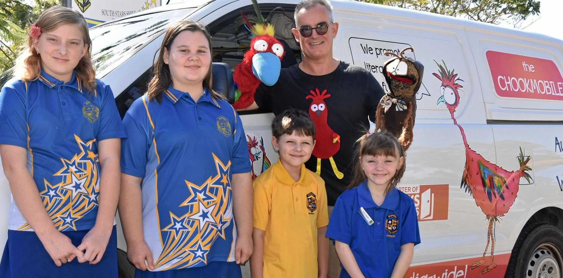 GET FUNKY: Kallea Hughes (11), Janae Bartle (11), Jeremy Darro (6) and Alicia Roberts (6) with childrens' author Chris Collin at Gladstone South Primary School.