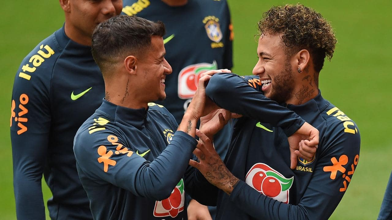 Brazil's midfielder Philippe Coutinho (L) and Brazil's striker Neymar share a joke