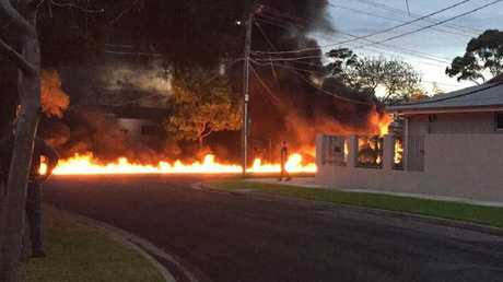 The street erupted in flames after the shocking landing. Courtesy: 7 News