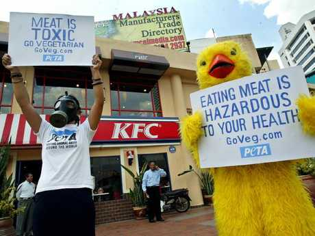 """"""" 'The caged poultry didn't stand a chance', said one protester, with tears rolling down her cheeks."""""""