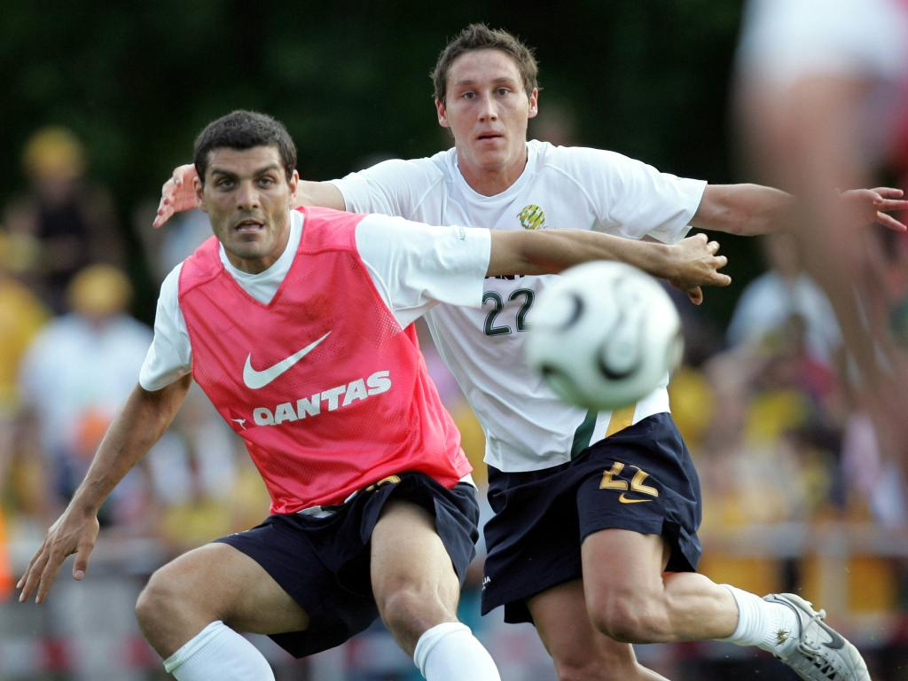 A fresh-faced Mark Milligan jousts with John Aloisi in 2006. Picture: Gregg Porteous