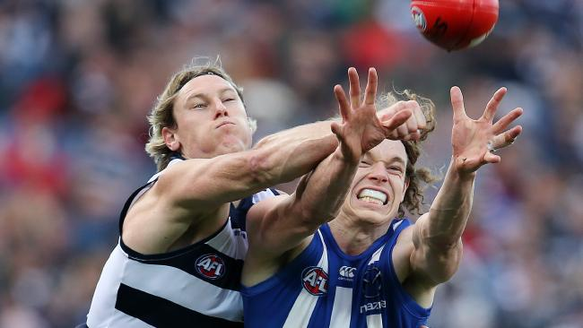 Mark Blicavs spoils North Melbourne forward Ben Brown. Picture: Michael Klein