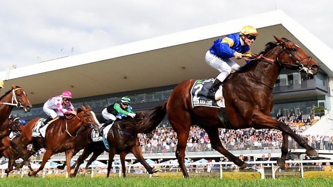 Corey Brown and three-year-old filly Champagne Cuddles (pink cap) finish third behind Santa Ana Lane. Picture: AAP
