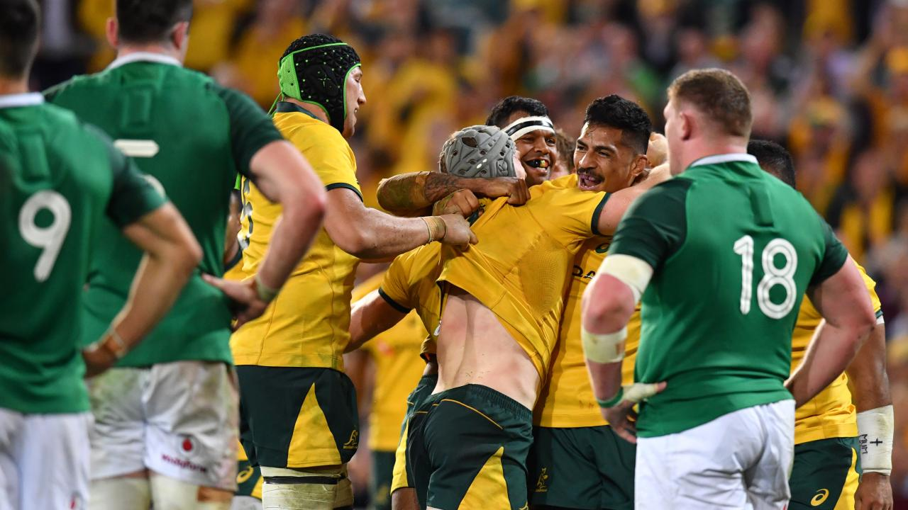 David Pocock (centre) celebrates after scoring a try against Ireland.