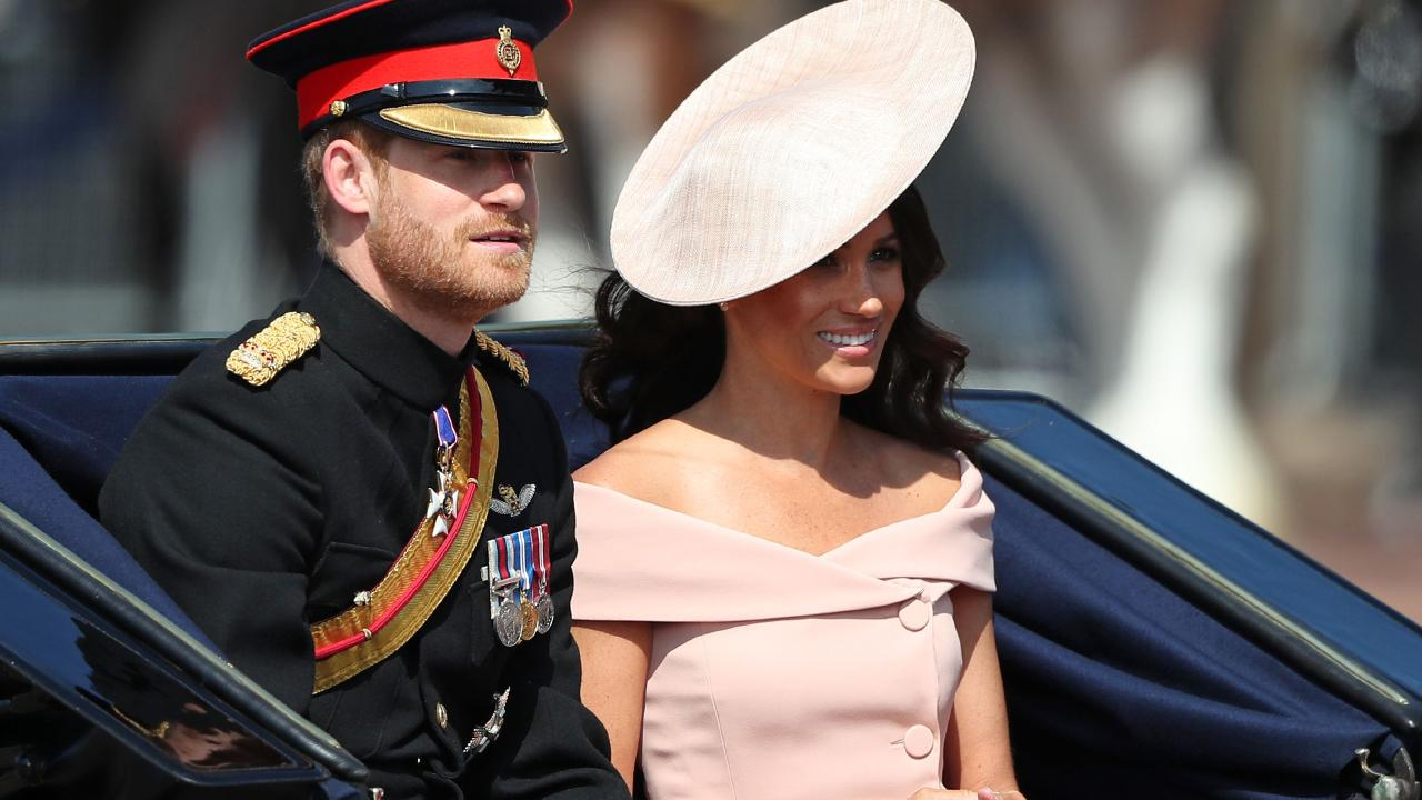 Prince Harry, Duke of Sussex and Meghan, Duchess of Sussex travel in a carriage to Horseguards parade ahead of the Queen's Birthday Parade, 'Trooping the Colour'. Picture: AFP