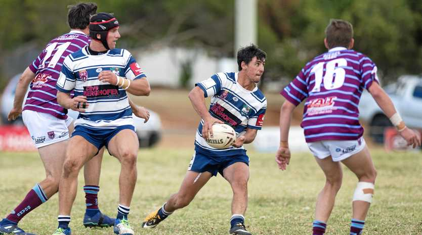Sam Betros looks to push the pass for Brothers against Goondiwindi.