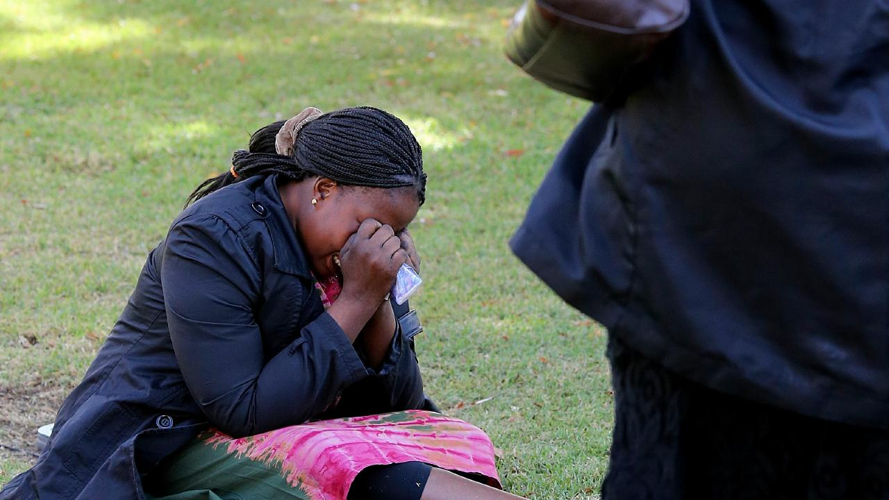 A mourner at the funeral for the lost family members. Picture: Tim Carrafa