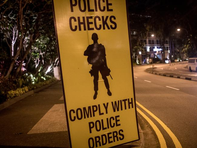 A police sign is seen at the entrance to the Shangri-La Hotel where Trump is staying. Picture: Chris McGrath/Getty Images