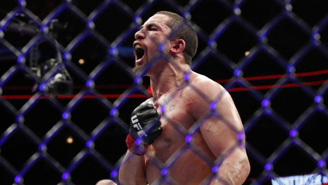 Robert Whittaker reacts after his middleweight mixed martial arts bout against Yoel Romero. (AP Photo/Jim Young)
