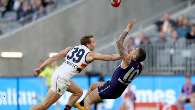 Tom Doedee attempts to spoil Michael Walters. Picture: AAP