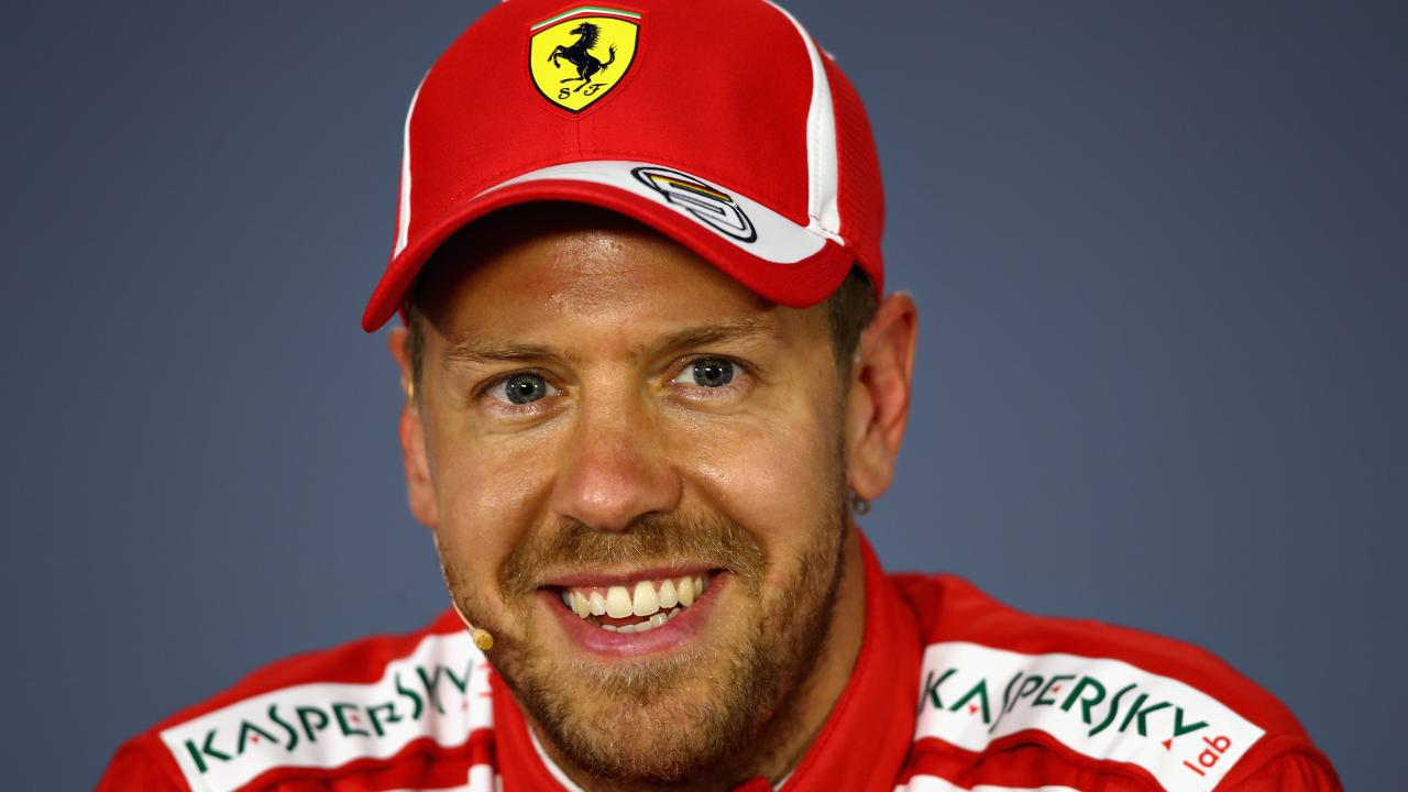 Pole position qualifier Sebastian Vettel talks in the press conference after qualifying.