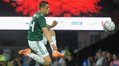 Denmark beat Javier Hernández' Mexico with second half goals from Yussuf Poulsen and Christian Eriksen.