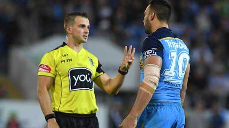 Referee Grant Atkins speaks with Titans captain Ryan James during the Round 14 NRL match between Gold Coast and South Sydney. Picture: AAP
