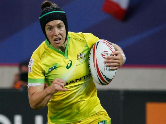Australia's Emilee Cherry runs with the ball