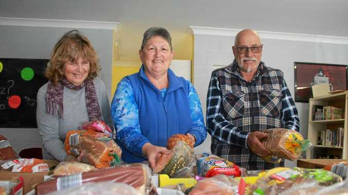 GOOD FOOD: Volunteers Anna Spicer and Donna and Roger Boswell prepare Foodbank boxes to be taken to those in need.