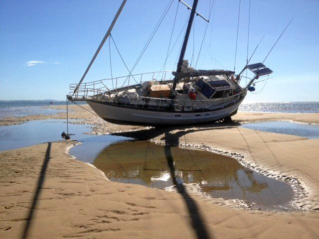 STUCK FAST: It took almost 24 hours for a stranded 36-foot yacht to free itself from the Round Hill sandbar.
