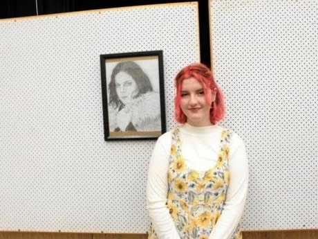 Ella Freelander with her work 'In the cold, cold night' who won the youth most outstanding art award.