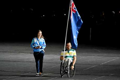 Flagbearer Kurt Fearnley enters the stadium before the start of the closing ceremony at the 2018 Gold Coast Commonwealth Games. Picture: Dan Peled/AAP