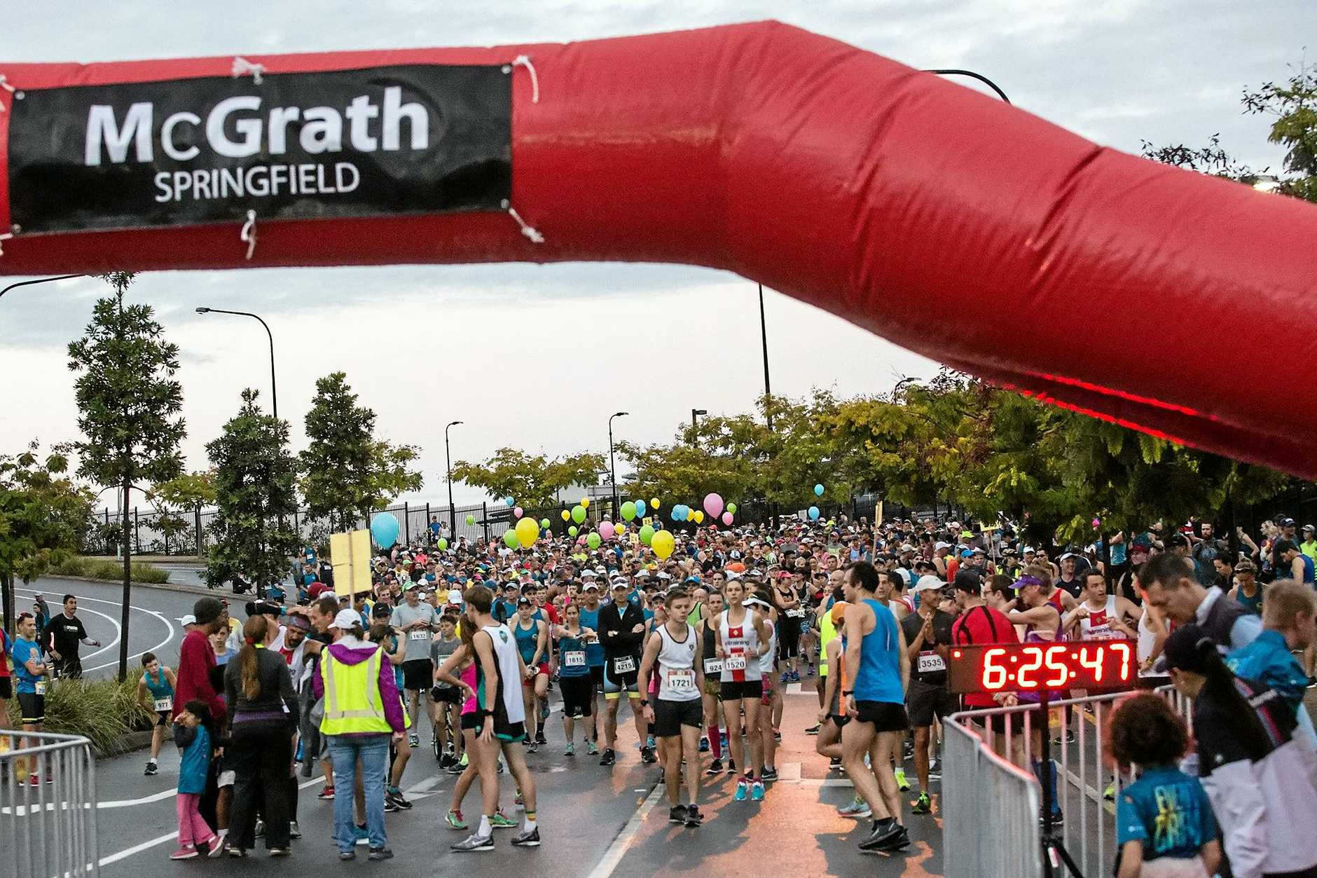 Runners prepare to start the inaugural Greater Springfield Marathon events on Sunday morning.