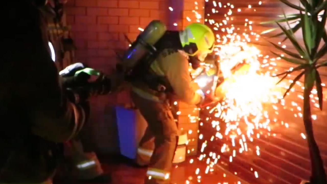 NSW Fire and Rescue desperately attending and extinguishing the blaze. Picture: Dean Asher