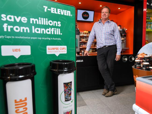 Closed Loop Managing Director Rob Pascoe at a Port Melbourne 7 Eleven with the collection tubes that Closed Loop have made to encourage recycling of coffee cups and slurpee cups. Picture: Penny Stephens