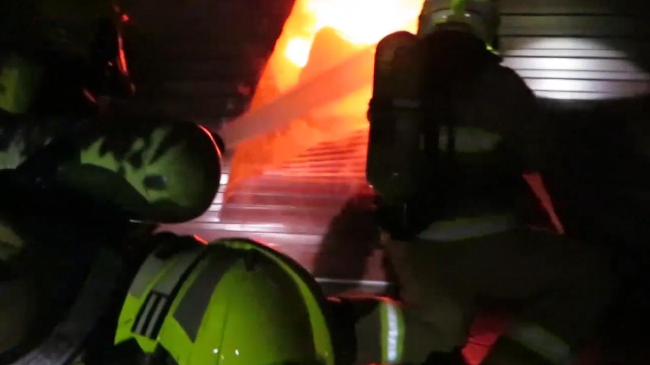 Firefighters battle the blaze. Picture: Dean Asher