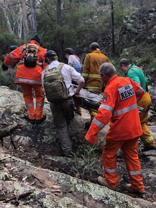 Emergency service volunteers carrying the fallen Premier. Picture: Jay Weatherill/Facebook