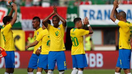 Fernandinho and his Brazilian teammates applaud the fans.