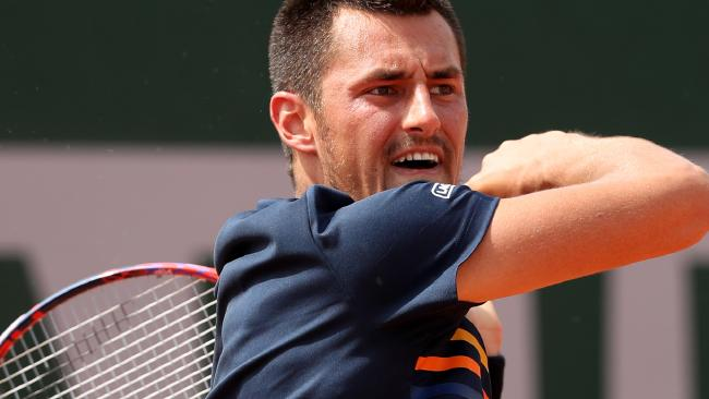 PARIS, FRANCE - MAY 28: Bernard Tomic of Australia plays a forehand during the mens singles firt round match against Marco Trungelliti of Argentina during day two of the 2018 French Open at Roland Garros on May 28, 2018 in Paris, France. (Photo by Matthew Stockman/Getty Images)