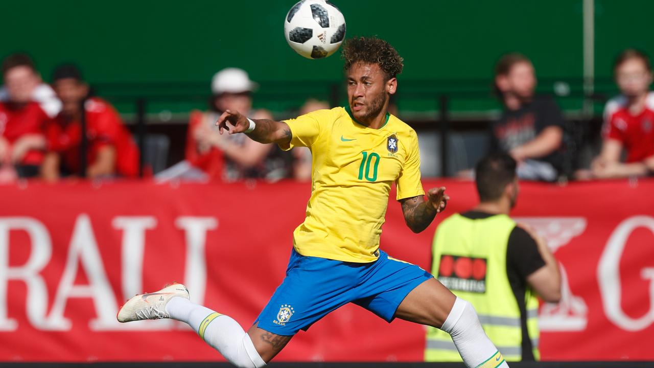 Neymar of Brazil heads the ball against Austria.