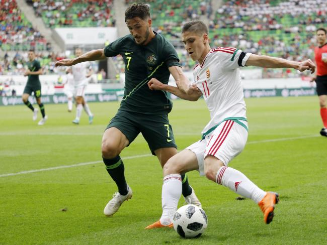 Mathew Leckie forces Hungary player Roland Sallai into the corner.