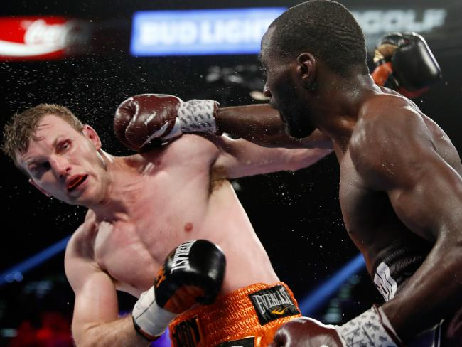 Terence Crawford (R) throws a right at Jeff Horn