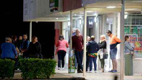 Parents gather outside Kimberley College's 'company member' meeting on Monday night. Picture: mage AAP/Steve Pohlner