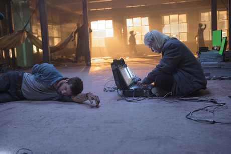 Logan Marshall-Green, left, in a scene from the movie Upgrade.