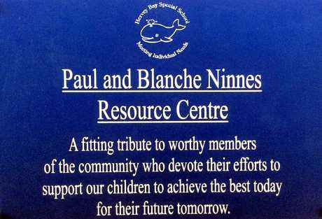 The plaque which is mounted to the wall of the resource centre.