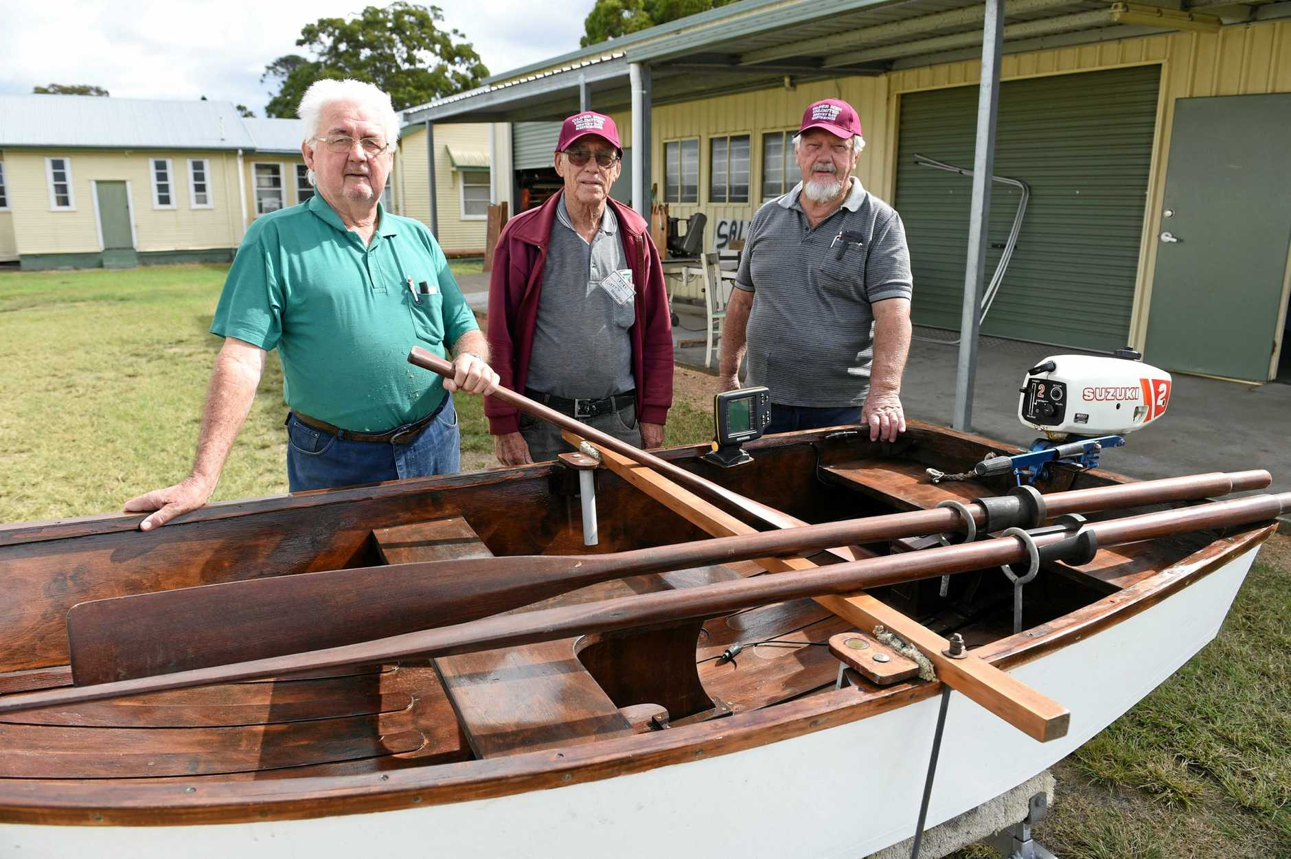 Older Men Unlimited Maryborough - (L) Frank Grant, Garry Monaghan and Theo Svensen with a boat they refurbished.