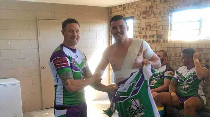 ON DEBUT: Jacob Flanagan is handed an A-Grade jumper by Brahmans captain Sam Key ahead of Sunday clash against the Crocs.