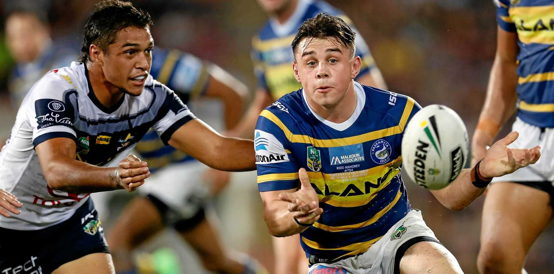 BALL PLAYER:  Reed Mahoney of the Eels passes the ball during the round 14 NRL match between the Parramatta Eels and the North Queensland Cowboys at TIO Stadium in Darwin.