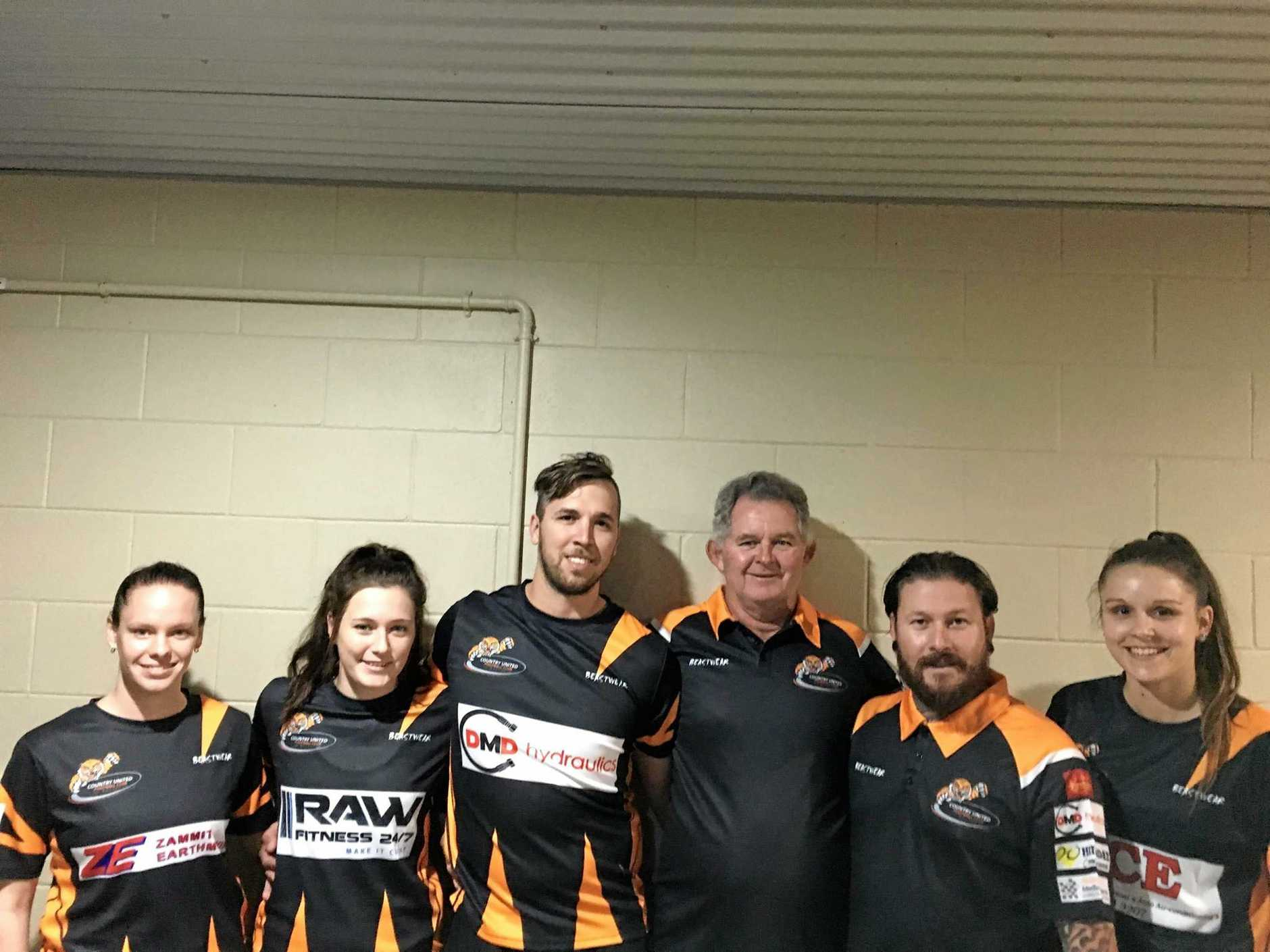 Country United Tigers don their new orange and black strips.